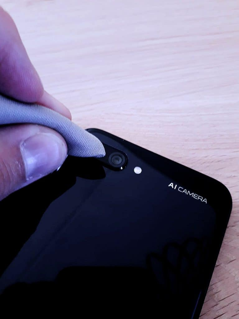 Cleaning Phone Lens with Microfiber Cloth